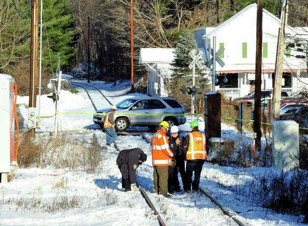 This is the scene where a car was hit by a train at a railroad crossing in West Redding Center Sunday, Dec. 30, 2012. Photo: Michael Duffy