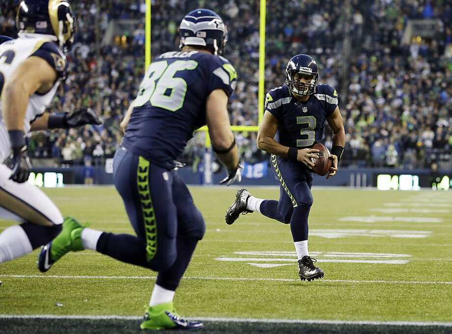 Seattle's Russell Wilson scores the game-winning touchdown with 1:39 left against St. Louis. Photo: Elaine Thompson, Associated Press