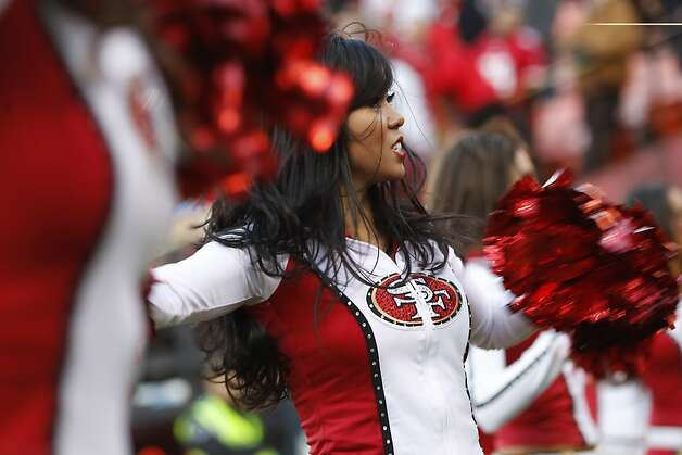 A cheerleader with the San Francisco 49ers Gold Rush dances during a NFL football game between the San Francisco 49ers and Arizona Cardinals at Candlestick Park in San Francisco, Calif. on Sunday, December 30, 2012. Photo: Stephen Lam, Special To The Chronicle