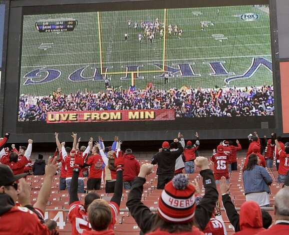 49er fans watch the Minnesota Vikings beat the Green Bay Packers on TV after the 49ers beat the Cardinals 27-13 at Candlestick Park in San Francisco on Sunday, November 30th, 2012. Photo: John Storey, Special To The Chronicle