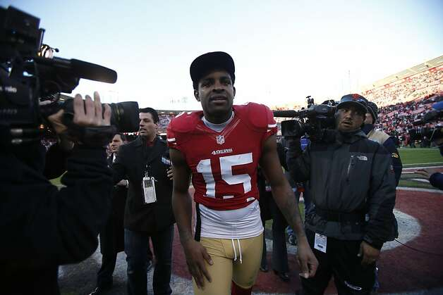 San Francisco 49ers wide receiver Michael Crabtree (15) is surrounded by members of the media after the team's 27-13 victory over the visiting Arizona Cardinals at Candlestick Park in San Francisco, Calif. on Sunday, December 30, 2012. Photo: Stephen Lam, Special To The Chronicle