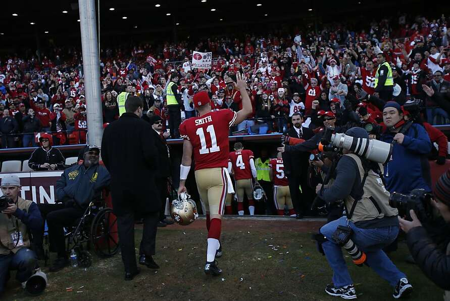 San Francisco 49ers quarterback Alex Smith (11) waves to the fans as he leaves the field after th