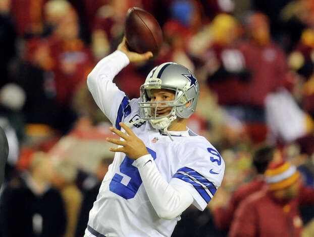 Dallas Cowboys quarterback Tony Romo warms up before an NFL football game against the Washington Redskins Sunday, Dec. 30, 2012, in Landover, Md. (AP Photo/Richard Lipski) Photo: Richard Lipski, Associated Press / FR170623 AP