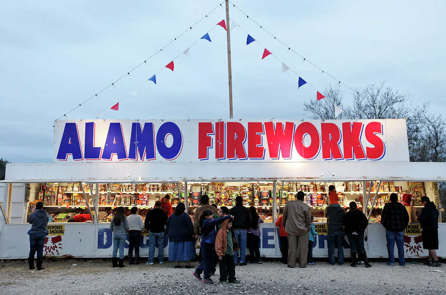 People buy fireworks Sunday Dec. 30, 2012 at the Alamo Fireworks stand in the 2800 block of Pue Road. Photo: Edward A. Ornelas, San Antonio Express-News / © 2012 San Antonio Express-News