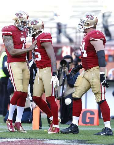Quarterback Colin Kaepernick (7) celebrates with Wide receiver Michael Crabtree (15) and Offensive tackle Joe Staley (74) after a Crabtree touchdown in the third quarter of the San Francisco 49ers game against the Arizona Cardinals at Candlestick Park in San Francisco, Calif., on Sunday December 30, 2012. Photo: Carlos Avila Gonzalez, The Chronicle