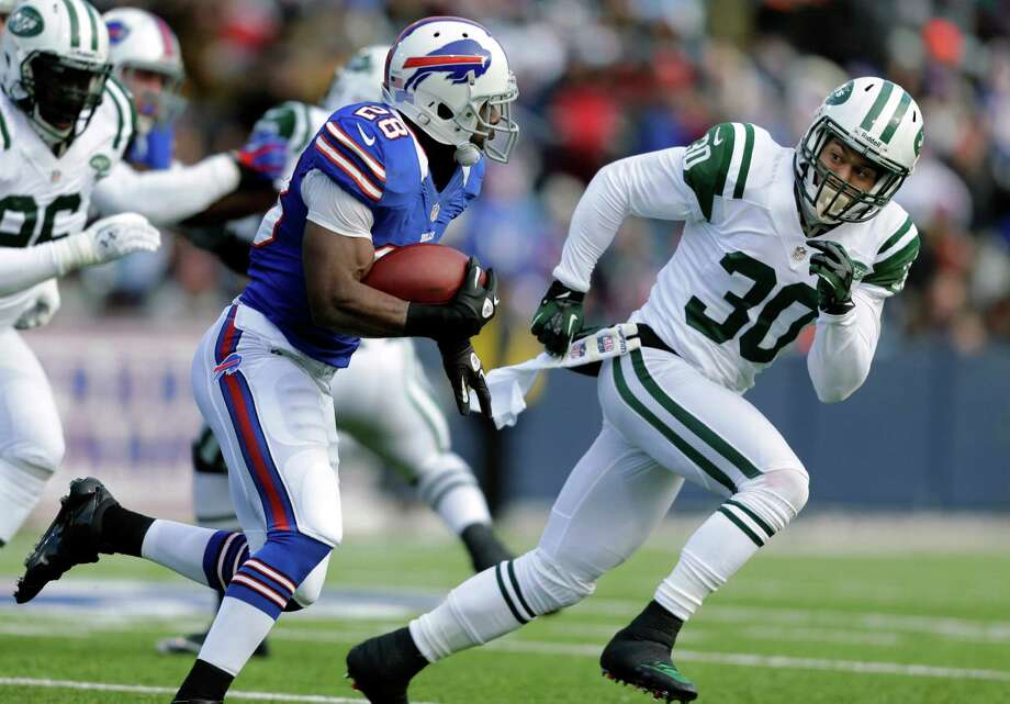 New York Jets free safety LaRon Landry (30) moves in for a tackle on Buffalo Bills running back C.J. Spiller (28) during the first half an NFL football game on Sunday, Dec. 30, 2012, in Orchard Park, N.Y. (AP Photo/Mel Evans) Photo: Mel Evans