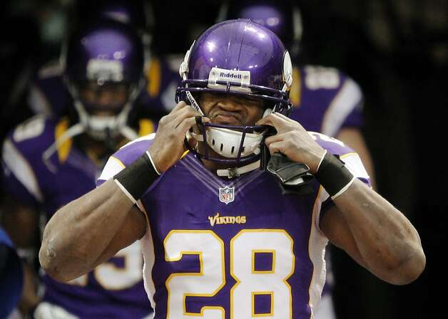 Minnesota Vikings running back Adrian Peterson (28) puts on his helmet as he enters the field before the start of their NFL football game against the Green Bay Packers Sunday, Dec. 30, 2012, in Minneapolis. (AP Photo/Genevieve Ross) Photo: Genevieve Ross, Associated Press