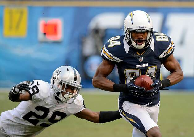 SAN DIEGO, CA - DECEMBER 30: Danario Alexander #84 of the San Diego Chargers catches the ball while being covered by Brandian Ross #29 of  the Oakland Raiders on December 30, 2012 at Qualcomm Stadium in San Diego, California. (Photo by Donald Miralle/Getty Images) Photo: Donald Miralle, Getty Images