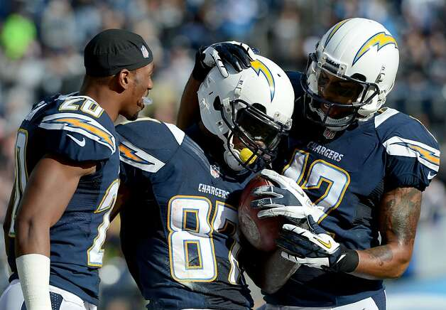 SAN DIEGO, CA - DECEMBER 30: Micheal Spurlock #87 of the San Diego Chargers is congratulated by his teammates after scoring a touchdown against the Oakland Raiders on December 30, 2012 at Qualcomm Stadium in San Diego, California. (Photo by Donald Miralle/Getty Images) Photo: Donald Miralle, Getty Images