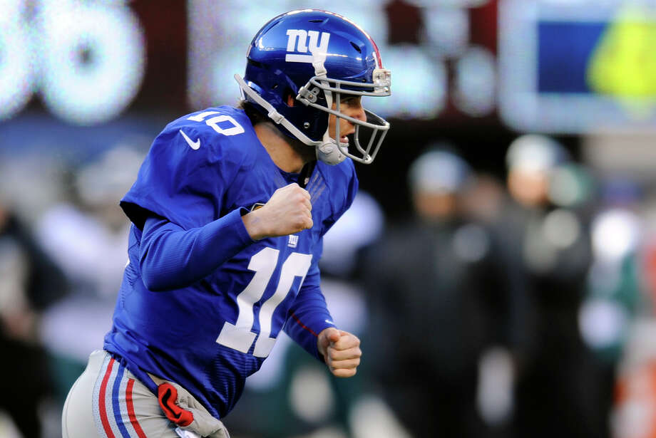 New York Giants quarterback Eli Manning (10) reacts after throwing a toucdown pass to Rueben Randle during the first half of an NFL football game against the Philadelphia Eagles, Sunday, Dec. 30, 2012, in East Rutherford, N.J. (AP Photo/Bill Kostroun) Photo: Bill Kostroun