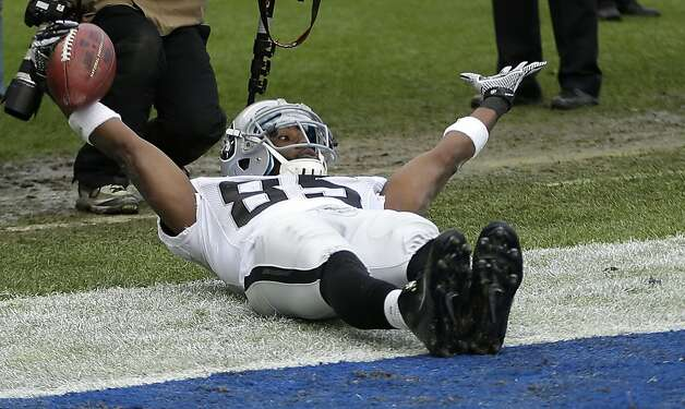 Oakland Raiders wide receiver Darrius Heyward-Bey motions to the officials after a touchdown catch in the end zone against the San Diego Chargers during the first half of an NFL football game Sunday, Dec. 30, 2012, in San Diego. (AP Photo/Lenny Ignelzi) Photo: Lenny Ignelzi, Associated Press