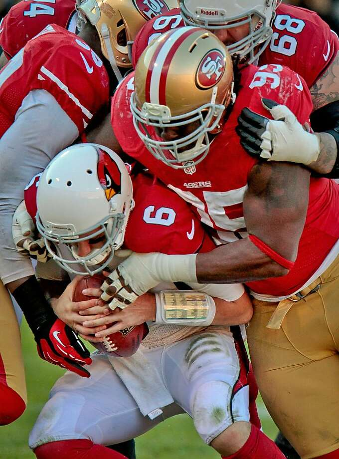 Ricky Jean Francois wraps up Brian Hoyer - and his role as starter, with Justin Smith's return for the playoffs likely. Photo: John Storey, Special To The Chronicle