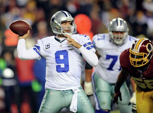 Dallas Cowboys quarterback Tony Romo (9) looks to pass during the first half of an NFL football game against the Washington Redskins Sunday, Dec. 30, 2012, in Landover, Md. (AP Photo/Nick Wass) Photo: Nick Wass, Associated Press / FR67404 AP