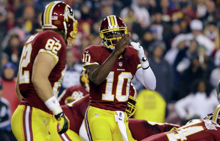 Washington Redskins quarterback Robert Griffin III calls timeout during the first half of an NFL football game against the Dallas Cowboys Sunday, Dec. 30, 2012, in Landover, Md. (AP Photo/Alex Brandon) Photo: Alex Brandon, Associated Press / AP