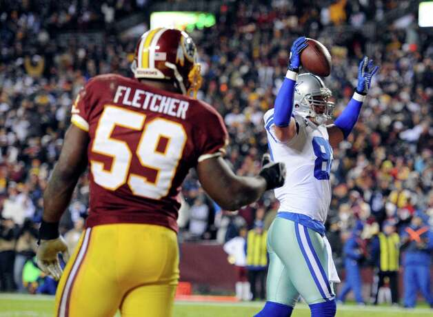 Dallas Cowboys tight end Jason Witten (82) celebrates his touchdown in front of Washington Redskins linebacker London Fletcher (59) during the first half of an NFL football game Sunday, Dec. 30, 2012, in Landover, Md. (AP Photo/Nick Wass) Photo: Nick Wass, Associated Press / FR67404 AP