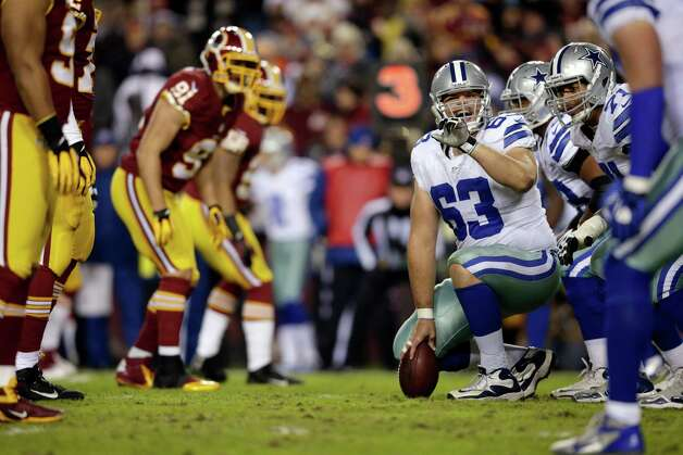 Dallas Cowboys center Ryan Cook (63) talks at the line of scrimmage during the first half of an NFL football game against the Washington Redskin Sunday, Dec. 30, 2012, in Landover, Md. (AP Photo/Evan Vucci) Photo: Evan Vucci, Associated Press / AP