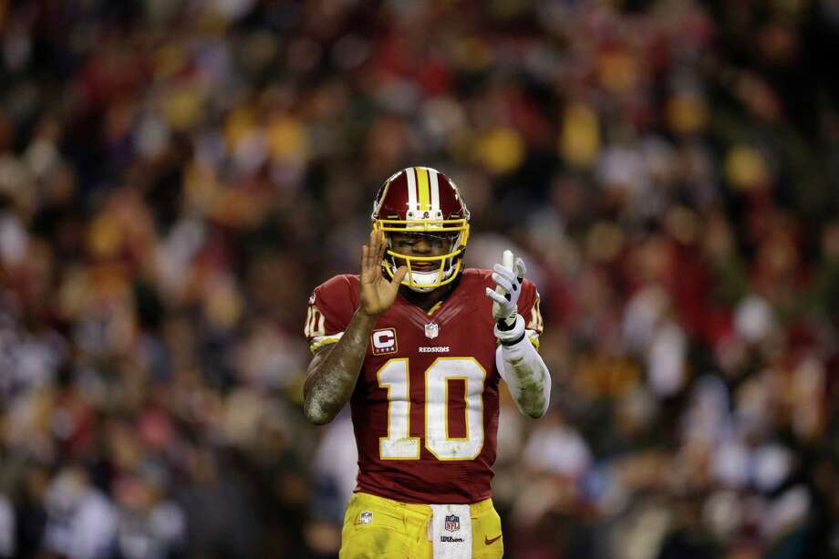 Washington Redskins quarterback Robert Griffin III (10) celebrates a touchdown during the first half of an NFL football game against the Dallas Cowboys Sunday, Dec. 30, 2012, in Landover, Md. (AP Photo/Evan Vucci) Photo: Evan Vucci, Associated Press / AP