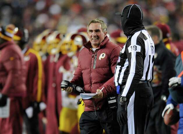 Washington Redskins head coach Mike Shanahan talks with an official during the first half of an NFL football game against the Dallas Cowboys Sunday, Dec. 30, 2012, in Landover, Md. (AP Photo/Nick Wass) Photo: Nick Wass, Associated Press / FR67404 AP