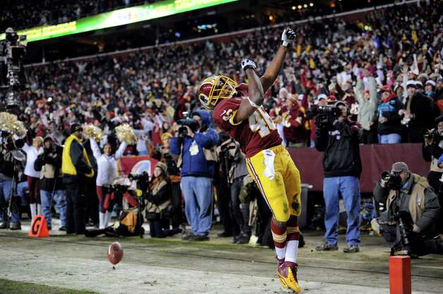 Washington Redskins running back Alfred Morris (46) celebrates his touchdown during the first half of an NFL football game against the Dallas Cowboys, Sunday, Dec. 30, 2012, in Landover, Md. (AP Photo/Nick Wass) Photo: Nick Wass, Associated Press / FR67404 AP