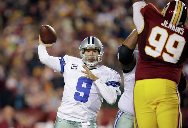 Dallas Cowboys quarterback Tony Romo (9) throws a pass during the first half of an NFL football game against the Washington Redskins Sunday, Dec. 30, 2012, in Landover, Md. (AP Photo/Evan Vucci) Photo: Evan Vucci, Associated Press / AP