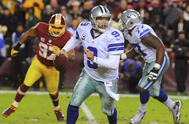 Dallas Cowboys quarterback Tony Romo (9) scrambles during the first half of an NFL football game against the Washington Redskins on Sunday, Dec. 30, 2012, in Landover, Md. (AP Photo/Richard Lipski) Photo: Richard Lipski, Associated Press / FR170623 AP