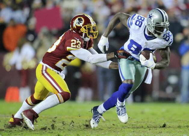 Dallas Cowboys wide receiver Dez Bryant (88) is stopped by Washington Redskins cornerback DeAngelo Hall (23) during the first half of an NFL football game Sunday, Dec. 30, 2012, in Landover, Md. (AP Photo/Nick Wass) Photo: Nick Wass, Associated Press / FR67404 AP