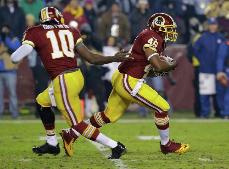 Washington Redskins quarterback Robert Griffin III (10) hands off to running back Alfred Morris (46)