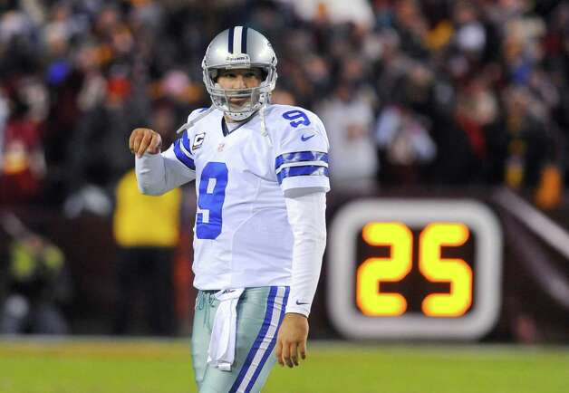 Dallas Cowboys quarterback Tony Romo reacts after throwing his second interception during the first half of an NFL football game against the Washington Redskins, Sunday, Dec. 30, 2012, in Landover, Md. (AP Photo/Richard Lipski) Photo: Richard Lipski, Associated Press / FR170623 AP