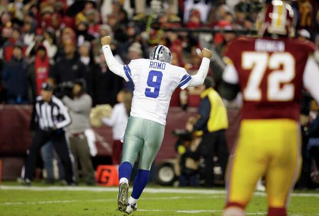 Dallas Cowboys quarterback Tony Romo (9) celebrates a touchdown during the first half of an NFL football game against the Washington Redskins Sunday, Dec. 30, 2012, in Landover, Md. (AP Photo/Evan Vucci) Photo: Evan Vucci, Associated Press / AP