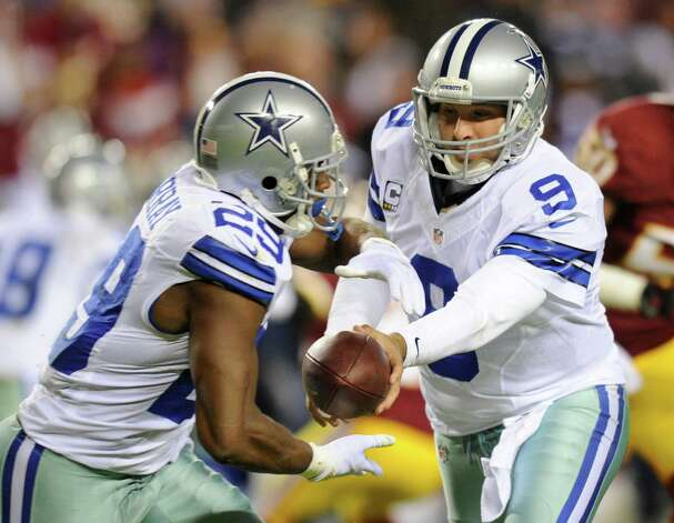 Dallas Cowboys quarterback Tony Romo (9) hands the ball off to Dallas Cowboys running back DeMarco Murray (29) during the first half of an NFL football game against the Washington Redskins Sunday, Dec. 30, 2012, in Landover, Md. (AP Photo/Nick Wass) Photo: Nick Wass, Associated Press / FR67404 AP
