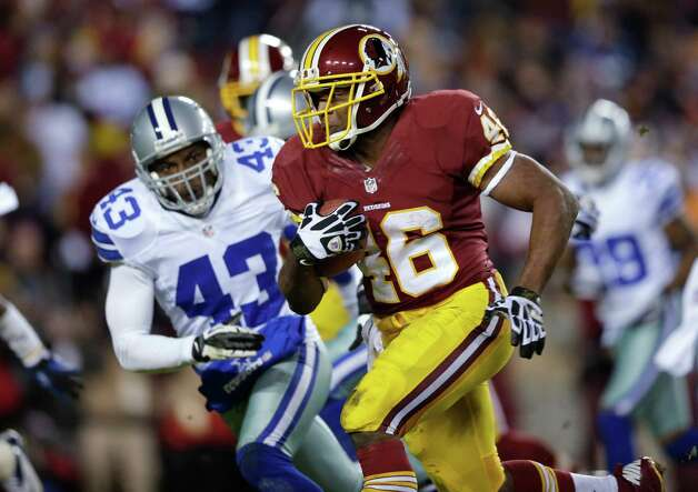 Washington Redskins running back Alfred Morris (46) outruns Dallas Cowboys free safety Gerald Sensabaugh (43) for a touchdown during the first half of an NFL football game Sunday, Dec. 30, 2012, in Landover, Md. (AP Photo/Evan Vucci) Photo: Evan Vucci, Associated Press / AP