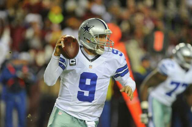 Dallas Cowboys quarterback Tony Romo (9) looks to pass during the first half of an NFL football game against the Washington Redskins Sunday, Dec. 30, 2012, in Landover, Md. (AP Photo/Richard Lipski) Photo: Richard Lipski, Associated Press / FR170623 AP
