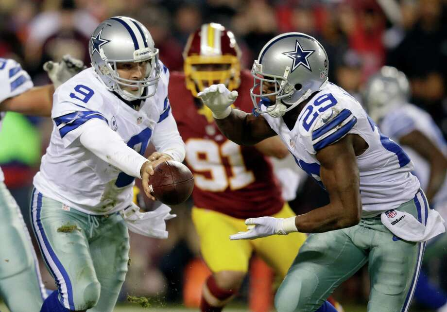 Dallas Cowboys quarterback Tony Romo (9) hands the ball off to running back DeMarco Murray (29) during the first half of an NFL football game against the Washington Redskins Sunday, Dec. 30, 2012, in Landover, Md. (AP Photo/Evan Vucci) Photo: Evan Vucci, Associated Press / AP