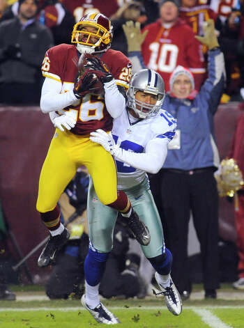 Washington Redskins cornerback Josh Wilson (26) makes the catch for an interception in front of Dallas Cowboys wide receiver Miles Austin (19) during the first half of an NFL football game Sunday, Dec. 30, 2012, in Landover, Md. (AP Photo/Richard Lipski) Photo: Richard Lipski, Associated Press / FR170623 AP