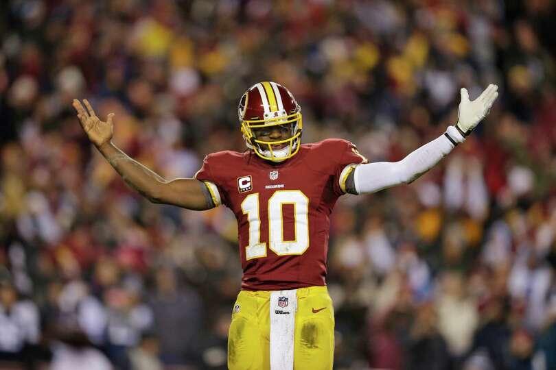Washington Redskins quarterback Robert Griffin III (10)  celebrates a touchdown during the first hal