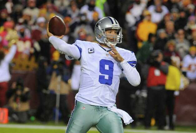 Dallas Cowboys quarterback Tony Romo (9) passes the ball during the first half of an NFL football game against the Washington Redskins Sunday, Dec. 30, 2012, in Landover, Md. (AP Photo/Richard Lipski) Photo: Richard Lipski, Associated Press / FR170623 AP
