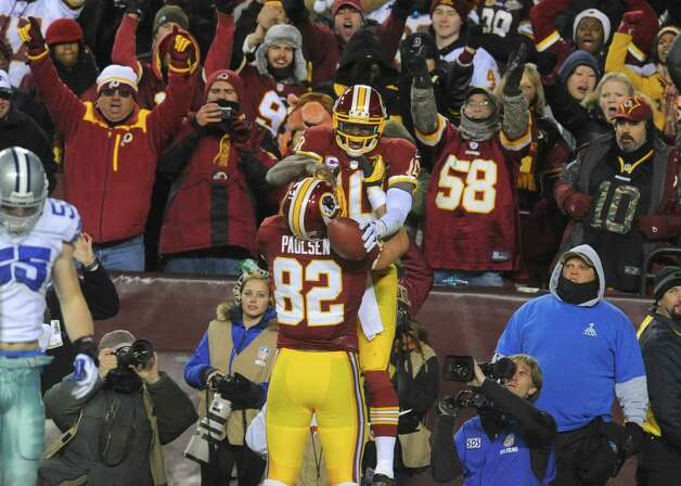 Washington Redskins quarterback Robert Griffin III (10) celebrates his touchdown with tight end Logan Paulsen (82) during the second half of an NFL football game against the Dallas Cowboys Sunday, Dec. 30, 2012, in Landover, Md. (AP Photo/Richard Lipski) Photo: Richard Lipski, Associated Press / FR170623 AP