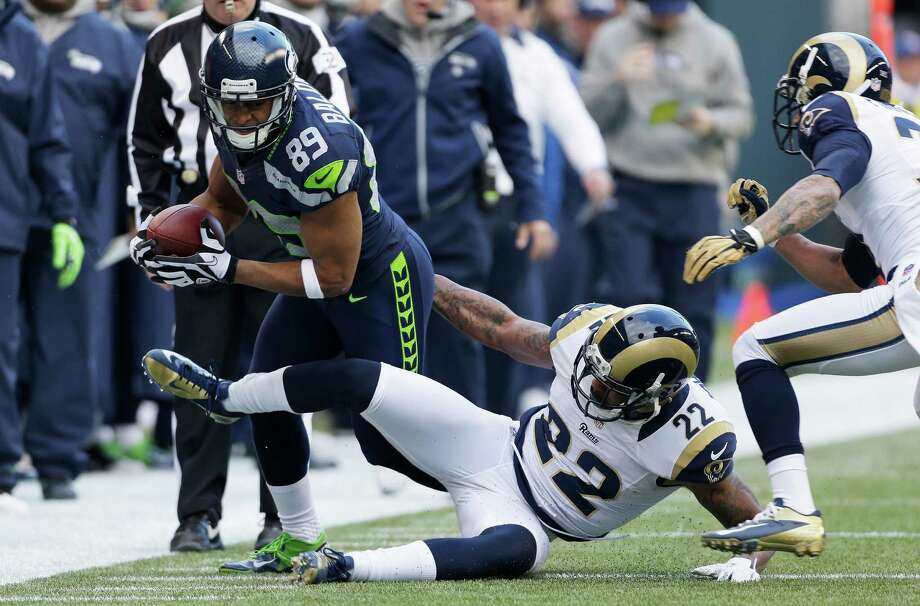 Seattle Seahawks' Doug Baldwin, left, in action against the St. Louis Rams in the first half of an NFL football game, Sunday in Seattle. Photo: AP Photo/Elaine Thompson