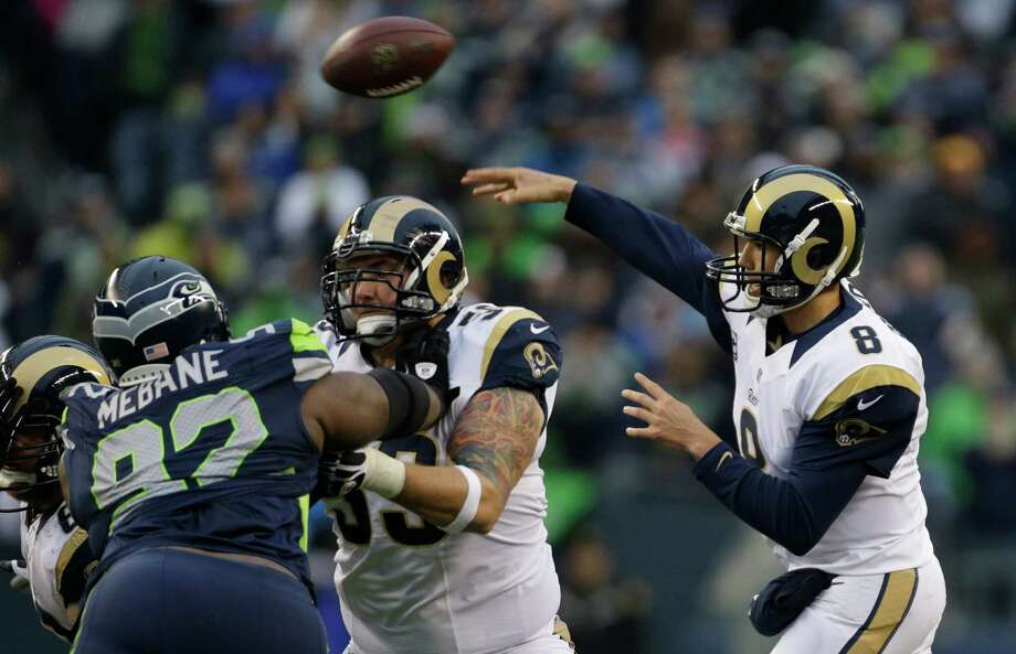 St. Louis Rams quarterback Sam Bradford passes against the Seattle Seahawks in the second half of an NFL football game, Sunday in Seattle. Photo: AP Photo/Elaine Thompson