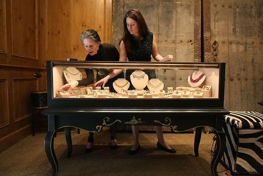 Meriwether McGettigan (left) and daughter Fay McGettigan prepare jewelry for sale at the boutique Meriwether in Presidio Heights, which recently celebrated its sixth anniversary. Photo: Liz Hafalia, The Chronicle