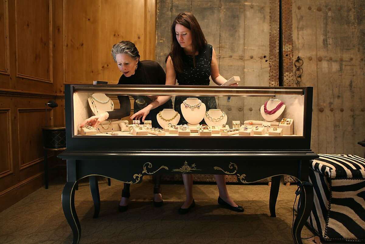 Meriwether McGettigan (left) and daughter Fay McGettigan prepare jewelry for sale at the boutique Meriwether in Presidio Heights, which recently celebrated its sixth anniversary.
