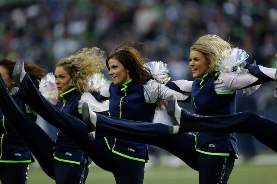 Seattle Seahawks Sea Gals cheerleaders perform in the second half of an NFL football game against the St. Louis Rams, Sunday in Seattle. Photo: AP Photo/Elaine Thompson