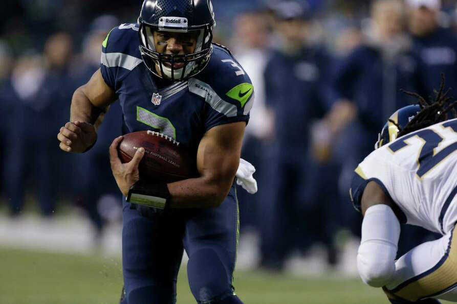 Seattle Seahawks' Russell Wilson in action against the St. Louis Rams in the second half of an NFL f