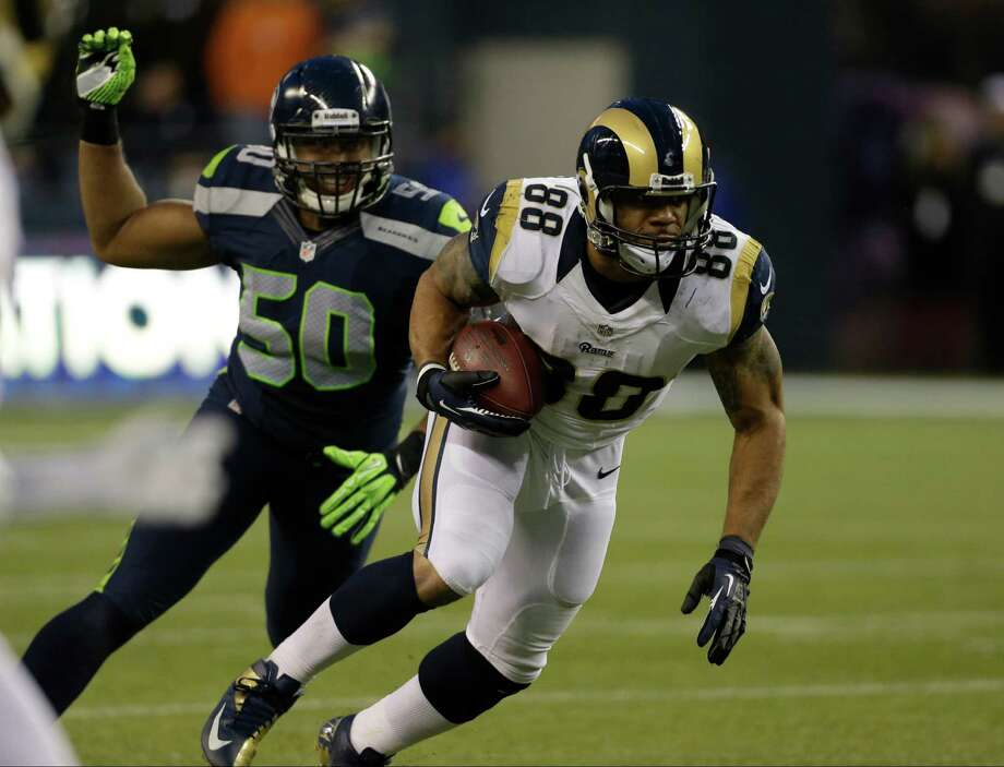 St. Louis Rams' Lance Kendricks (88) runs as he is pursued by Seattle Seahawks' K.J. Wright in the second half of an NFL football game, Sunday in Seattle. The Seahawks won 20-13. Photo: AP Photo/Elaine Thompson