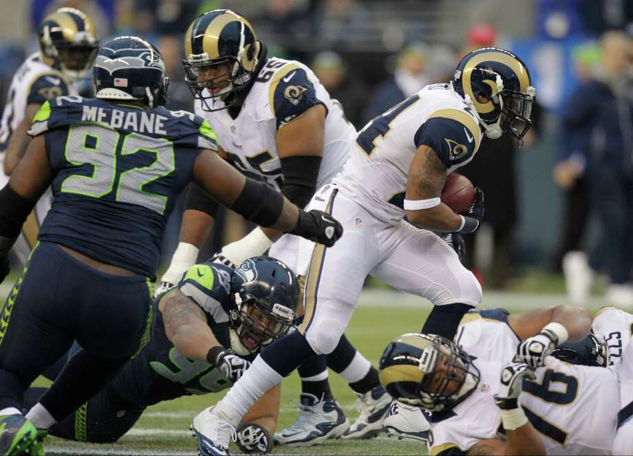 St. Louis Rams running back Isaiah Pead rushes the ball in the second half of an NFL football game against the Seattle Seahawks, Sunday in Seattle. (AP Photo/Stephen Brashear) Photo: AP Photo/Elaine Thompson