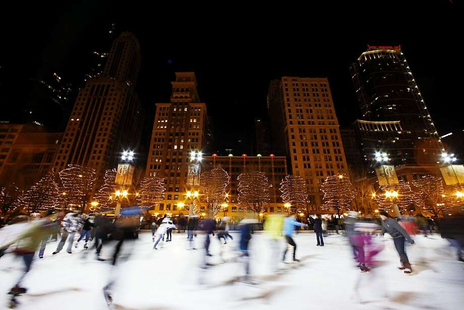 People skate on an ice rink in Chicago, Sunday, Dec. 30, 2012. Snow and cold have been lacking in Chicago recently and one of the city's winterless weather streaks has now tied an all-time record. (AP Photo/Nam Y. Huh) Photo: Nam Y. Huh, Associated Press