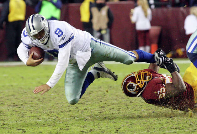 Dallas Cowboys quarterback Tony Romo is brought down by Redskins linebacker London Fletcher in the fourth quarter as the Washington Redskins faced the Dallas Cowboys, Sunday, December 30, 2012 in Landover, Maryland. (Linda D. Epstein/MCT) Photo: Linda D. Epstein, McClatchy-Tribune News Service / MCT