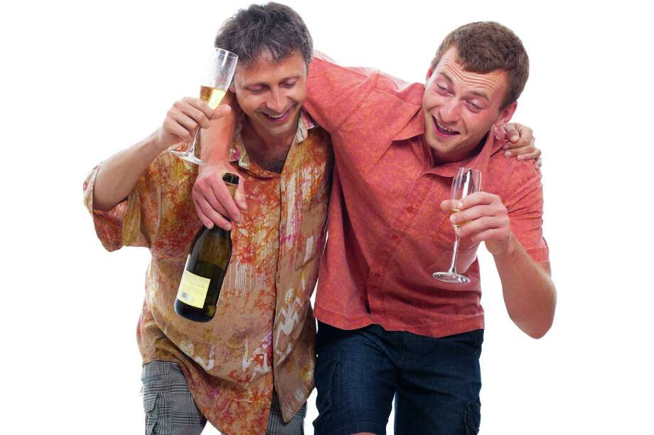 Two happy drunken men with bottle and glass of alcohol, isolated on white background. Photo: Jan Mika / JanMika - Fotolia