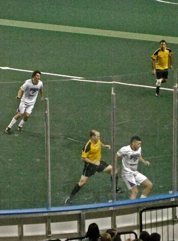Texas Strikers battle Dallas Sidekicks in the final minutes of a home game Saturday at Ford Park. The fledgling team lost 15-4. Photo: Sarah Moore
