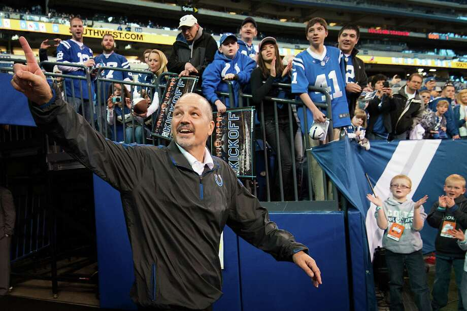 Colts head coach Chuck Pagano was all smiles while acknowledging the home crowd before Sunday's game, his first time on the sidelines since Sept. 23 after undergoing treatment for leukemia. Photo: Smiley N. Pool, Staff / © 2012  Houston Chronicle